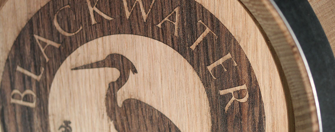 image of Blackwater Distillery logo on wooden barrel