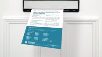 image of Capital Credit Union leaflet going through letterbox