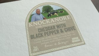 image of Knockanore Cheese product label cheddar with black pepper & chive