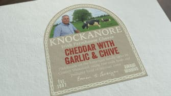 image of Knockanore Cheese product label cheddar with garlic & chive