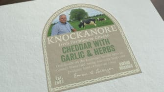 image of Knockanore Cheese product label cheddar with garlic & herb