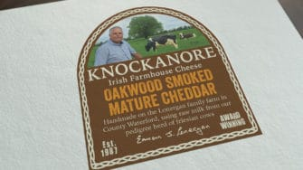image of Knockanore Cheese product label oakwood smoked mature cheddar