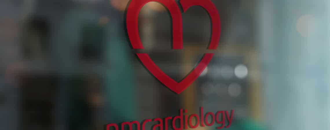 image of NM Cardiology signage on glass