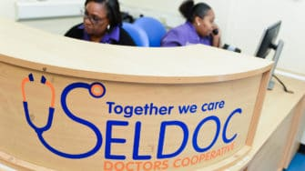 image of SELDOC branding on reception desk