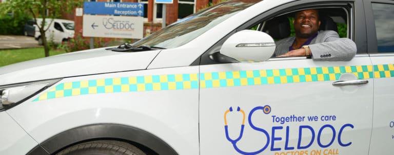 image of SELDOC branding on car
