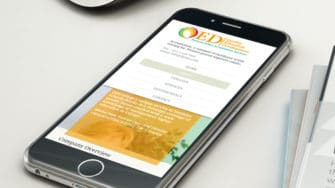 image of QED Accreditation Advisors website on mobile device