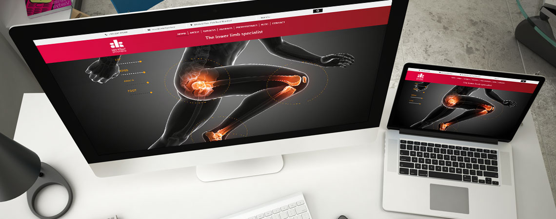 image of Ian Kelly website on desktop and laptop