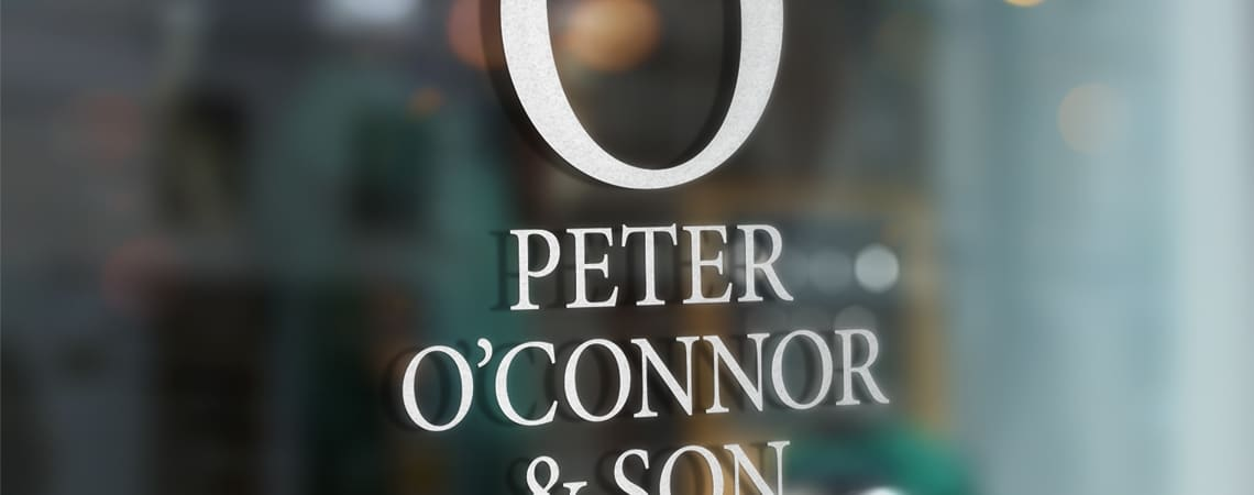 image of Peter O'Connor & Son signage on glass door