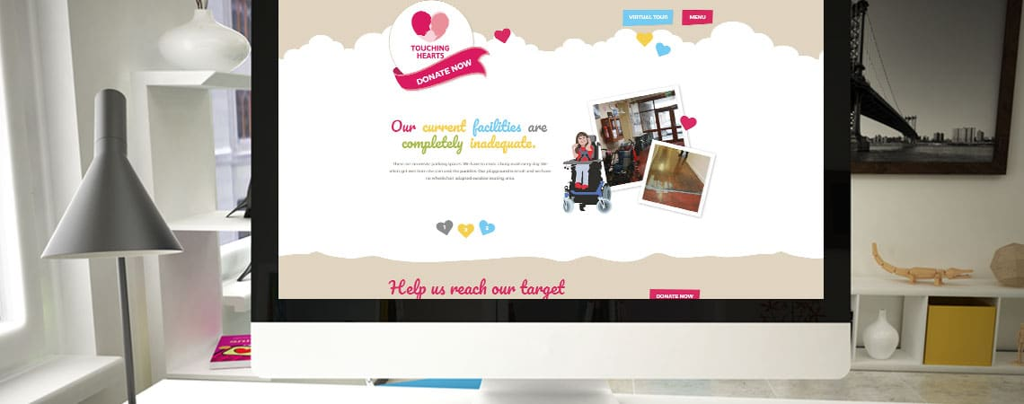 image of Touching Hearts website home page on desktop computer